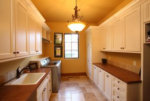 Traditional Laundry Room with travertine floors, Drop-in sink, laundry sink, flush light, Paint 1, Paint 2, Standard height