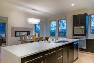 Contemporary Kitchen with Double sided fireplace, European Cabinets, dishwasher, Breakfast nook, Waterfall countertop, Flush