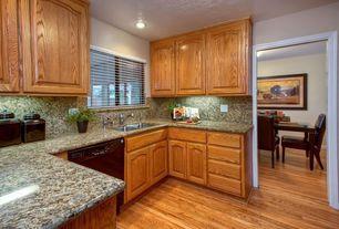 Traditional Kitchen with Simple granite counters, Simple Granite, Undermount sink, U-shaped, Hardwood floors, Raised panel