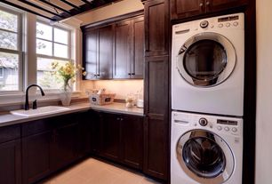 Craftsman Laundry Room with Dupont Zodiaq Dove Grey, Lg washer and dryer, Built-in bookshelf, Shaker style cabinetry