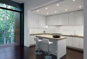 Modern Kitchen with Kitchen island, L-shaped, Limestone counters, can lights, Undermount sink, electric cooktop, Flush