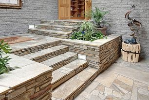 Traditional Staircase with Stacked stone wall, slate floors, Accent landscape lighting