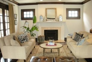 Traditional Living Room with Crown molding, metal fireplace, Hardwood floors