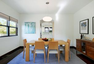 Contemporary Dining Room with Built-in bookshelf, Pendant light, Laminate floors