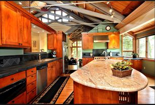 Craftsman Kitchen with Flat panel cabinets, Wall Hood, Paint 2, Paint 1, can lights, flush light, Kitchen island, gas range