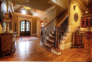 Traditional Entryway with Built-in bookshelf, High ceiling, Arched window, French doors, Hardwood floors, Chandelier, Columns