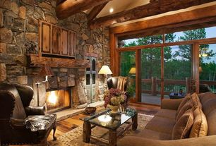 Rustic Living Room with French doors, High ceiling, Swing arm floor lamp, Hardwood floors, Transom window, Exposed beam