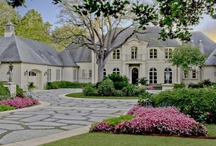 Traditional Exterior of Home with Arch window, Raised beds, Deck Railing, Paint, exterior stone floors, Glass panel door