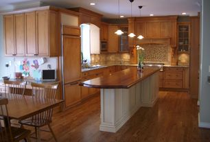 Country Kitchen with Undermount sink, Sapele mahogany edge grain wood, Simple granite counters, Wood counters, Kitchen island