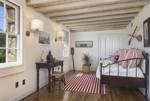 Traditional Guest Bedroom with Carpet, Hardwood floors, High ceiling, Wall sconce, Exposed beam