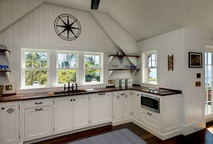 "Cottage Kitchen with Rustic Metal Star, 24"", High ceiling, French doors, Undermount sink, L-shaped, Soapstone counters"