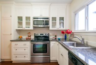 Traditional Kitchen with Complex granite counters, Flush, Flat panel cabinets, CliqStudios ROCKFORD Cabinetry, Paint1