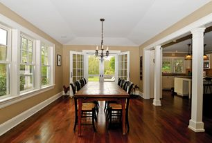 Traditional Dining Room with Columns, Chandelier, French doors, Hardwood floors