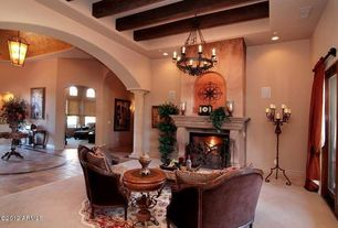 Mediterranean Living Room with Chandelier, French doors, Cement fireplace, Exposed beam ceiling, Columns, slate tile floors