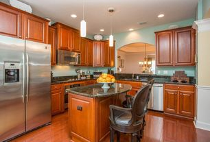 Traditional Kitchen with L-shaped, Breakfast bar, can lights, wall oven, Pendant light, dishwasher, Quartz counters, Flush