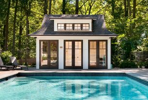 Craftsman Swimming Pool with exterior stone floors, Lap pool, French doors, Fence, Pathway
