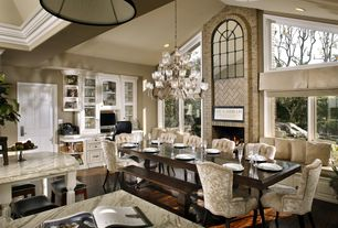 Traditional Dining Room with flush light, picture window, Arched window, Hardwood floors, Built-in bookshelf, Casement, Paint