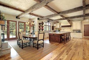 Mediterranean Great Room with Chandelier, Fireplace, stone fireplace, Pendant light, Hardwood floors, can lights, Casement