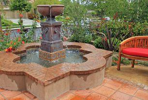 Mediterranean Patio with Fence, Pathway, Pond, Fountain, Bird bath, exterior terracotta tile floors, exterior tile floors