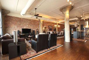 Eclectic Great Room with flush light, Built-in bookshelf, Wall sconce, interior brick, Hardwood floors, Chandelier, Columns