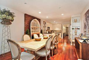 Modern Dining Room with Built-in bookshelf, Hardwood floors, Standard height, can lights