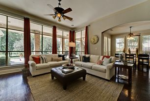 Traditional Great Room with Ceiling fan, Hardwood floors, Crown molding