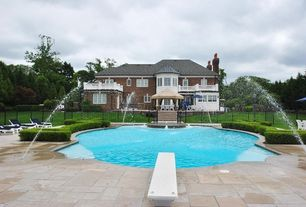 Traditional Swimming Pool with exterior stone floors, Fence, Fountain
