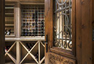 Mediterranean Wine Cellar with Built-in bookshelf, High ceiling, Glass panel door