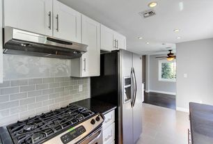 Contemporary Kitchen with Wall Hood, Gray subway tile backsplash, full backsplash, One-wall, Quartz counters, Paint 1