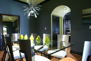 Modern Dining Room with High ceiling, Hardwood floors, Chandelier