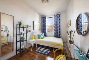 Contemporary Guest Bedroom with Ikea selje nightstand, Ikea reidar chair, Hardwood floors, Ikea vittsjo laptop table