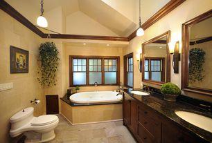 Craftsman Master Bathroom with Crown molding, Simple Granite, Arizona Tile, Jerusalem Gold, Limestone., Flat panel cabinets