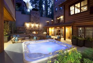 Contemporary Hot Tub with picture window, Arched window, Pathway, Fence, Deck Railing, exterior stone floors, Raised beds