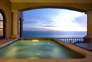 Mediterranean Hot Tub with exterior stone floors, Arched window, French doors, Pool with hot tub