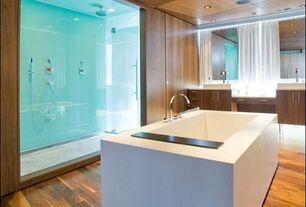 Contemporary Master Bathroom with frameless showerdoor, Vessel sink, Double sink, Master bathroom, Hardwood floors, Flush