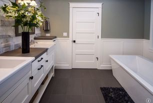 Traditional Master Bathroom with Kohler Stargaze 6' Freestanding Bath with Fluted Shroud and Center Drain, Wainscotting