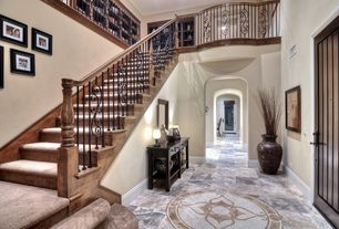 Craftsman Entryway with High ceiling, specialty door, soapstone tile floors, Boise river industries residential railing