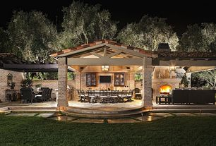 Craftsman Patio with Outdoor kitchen, exterior stone floors, Pathway