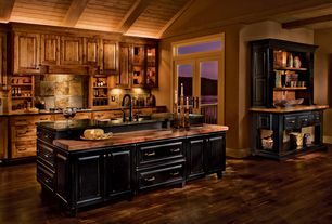 Rustic Kitchen with French doors, High ceiling, Raised panel, Slate Tile, Vaulted wood ceiling, Custom hood, Exposed beam
