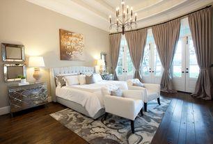 Traditional Master Bedroom with Tufted headboard, Chandelier, Hardwood floors, French doors, Triple french door, Area rug
