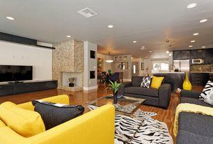 Contemporary Great Room with Built-in bookshelf, Pendant light, Glass panel door, Chandelier, Hardwood floors