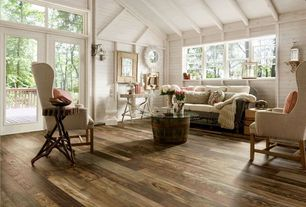 Country Living Room with High ceiling, Driftwood side table, French doors, Exposed beam, Wall sconce, Hardwood floors