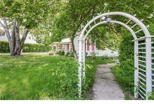 Traditional Landscape/Yard with Arched walkway