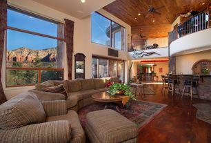 Rustic Great Room with Ceiling fan, Hardwood floors, Loft, High ceiling