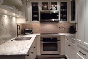 Traditional Kitchen with Standard height, 12-1/2 in. stainless-steel finish bar pull, Galley, Flat panel cabinets, Flush