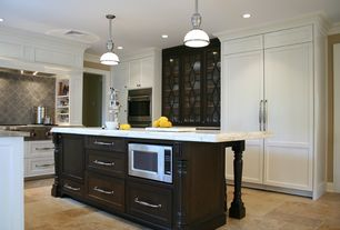 Traditional Kitchen with Flat panel cabinets, Framed Partial Panel, U-shaped, can lights, double wall oven, electric cooktop