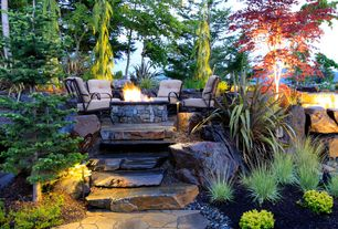 Rustic Patio with Fossill limestone round fire pit kit, exterior stone floors, Fire pit