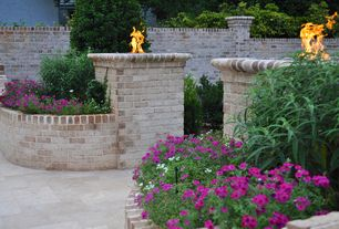 Traditional Landscape/Yard with Fire pit, Fence, Pathway, exterior stone floors, Raised beds