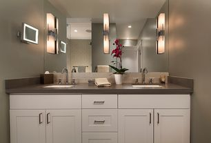 Contemporary Master Bathroom with Flat panel cabinets, specialty door, Soapstone counters, can lights, Standard height, Paint