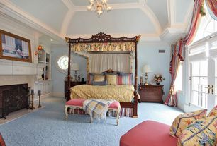 Traditional Master Bedroom with Arched window, High ceiling, Chandelier, Built-in bookshelf, Carpet, French doors